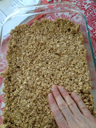 press it down firmly in a greased baking pan.